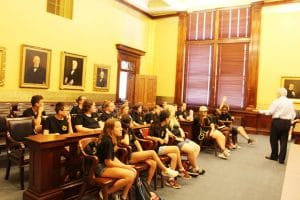 Truman youth listen as Hon. Paul C. Wilson talks about the types of cases the Missouri Supreme Court judges hear.
